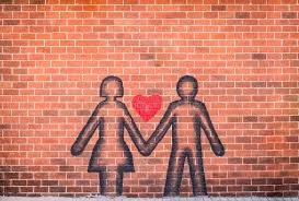couple in love sprayed paint on red brick wall stock photo image