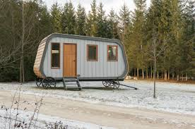 this modern prefab hut on wheels has all the cabin aesthetics
