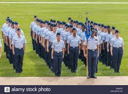 flight of airmen in dress blues stand at attention during united