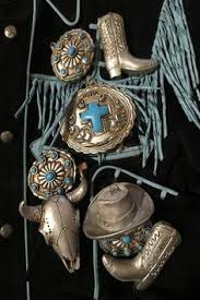 southwestern feather and longhorn skull ornaments on top of an