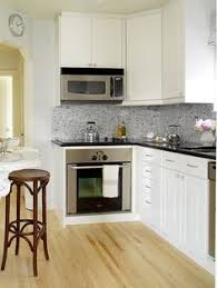 Wood Grain Laminate Cabinets Small Kitchen Idea Of The Day White Cabinets And Tile With Light