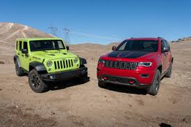jeep cherokee trailhawk white ultimate jeep head to head wrangler rubicon versus grand cherokee
