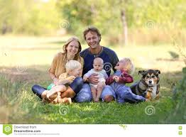garden family happy laughing family of 5 people and dog in sunny garden stock
