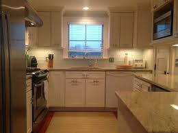 tiles backsplash tan kitchen backsplash white shaker cabinets