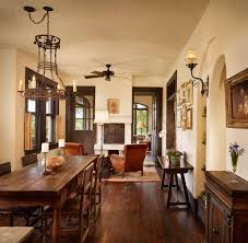Dark Floor Light Trim Dining Room Mediterranean With Ceiling Fan - Ceiling fan dining room