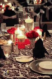 Floating Candle Centerpieces by Classic Red Rose Centerpieces With Floating Candles In Tall Vases