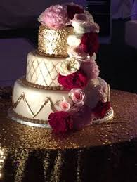 glamorous gold and white wedding cake table caroline ben