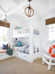 built in bunk beds are functional and adorable in this coastal