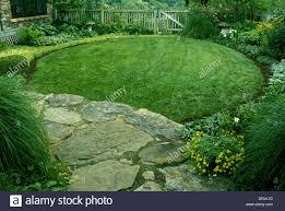 circular enclosed shade garden tucked next to house missouri usa