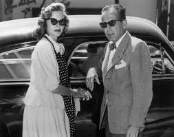 lauren bacall and humpfrey bogart wearing their ray ban sunglasses