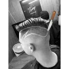 soft as butter mid skin fade with creative freestyle part haircut