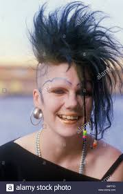 Half Shaved Hairstyles Girls by Punk Teen With Half Shaved Head And Unusual Black Eye Makeup