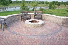 Outdoor Stone Firepits by Stacked Curvy Brick Stone Bench And Fire Pit With Black Metal