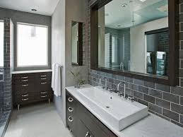 bathroom with black cabinets and mosaic backsplash tiles