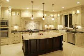 cream colored kitchen cabinets with dark island