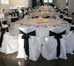 white tablecloth with black chair covers simply beatuiful