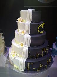 wedding cake design split cake design is half batman themed half ordinary wedding cake