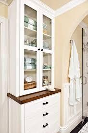 bathroom linen cabinet with glass doors a bathroom adds light no windows needed bathroom storage storage