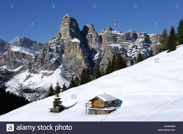 mountain backdrop log cabin with mountain backdrop in winter stock photo 14554795
