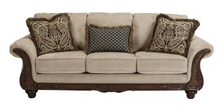 ashley furniture chair and ottoman sofas with wood accents