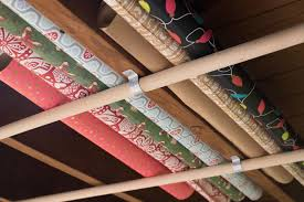 how to store wrapping paper and gift bags 10 ways to organize your wrapping paper and gift bags hgtv
