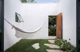 small courtyard with hammock casa da mangueira by alan chu up