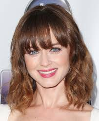 same haircut straight and curly short straight bangs with curly hair women hairstyles stock photos