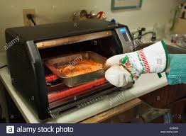 Cook Salmon In Toaster Oven Woman Removing Baked Salmon From Convection Oven Victoria British