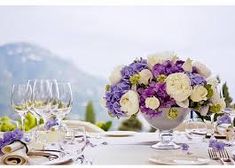 wedding centerpiece with blue and purple flowers png