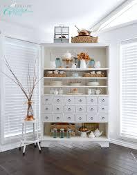 autumn apothecary open cabinet shelf decorating ideas apothecary