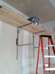 Hanging Shelves From Ceiling by Garage Shelves From Ceiling The Garage Journal Board