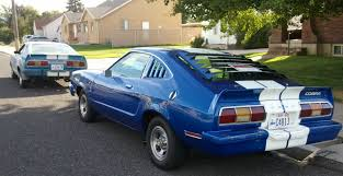 70s mustang on the road with zoom his and hers 70s era mustang cobras