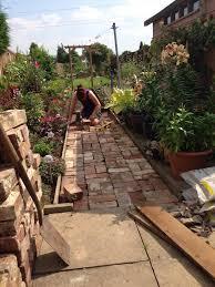 july project a reclaimed brick path u2013 a lush garden