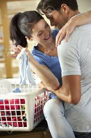 romantic couple sorting laundry in kitchen stock photo picture