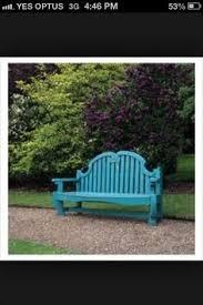 tangerine bench between blue pots gardens pinterest bench