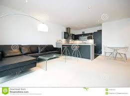 contemporary open plan living room with kitchen stock image