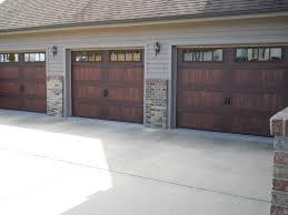 fatezzi faux wood garage doors new accents series from chi accents series 16x7 59xx u2013 ch
