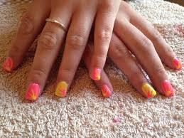 neon nails pink and yellow gel nails with flash sunset design