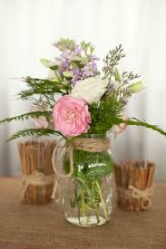 jar flower arrangements jar centerpiece diy rustic wedding styled pink