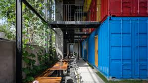 stacked shipping containers house bedrooms at vietnam hostel by