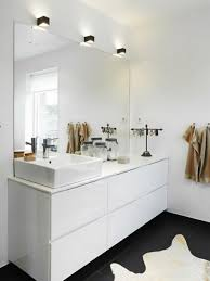 white vanity in luxuri bathroom like spa with white sink and big