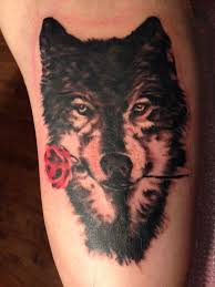 tattoo of a rose tattoo by mark at dinosaur studio tattoo of a wolf portrait with a