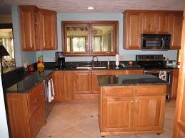 brown cabinetry in light blue wall paint decorations in small u