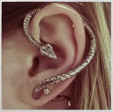 whisper earrings the snake always tries to whisper lies into our ears dope ear