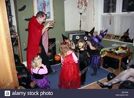 group of 2 4 year old children dressed up in halloween fancy dress