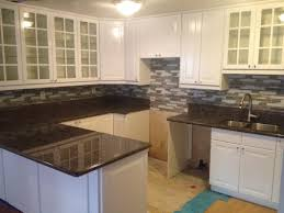 Laminating Flooring Wooden Laminating Flooring With White Cabinetry Also Black Granite