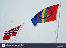 the sami flag and norwegian flag finnmark northern norway stock