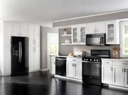 gray kitchen with white cabinets eclectic kitchen black white