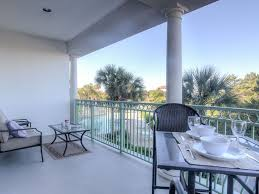 on 30a outdoor massive wrap around balcony with 3 different seating areas