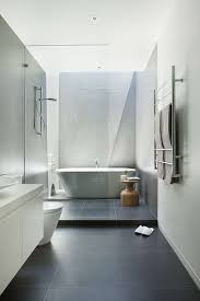 bathroom tile idea use large tiles on floor and walls 18